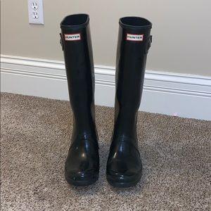 Black tall hunter boots glossy